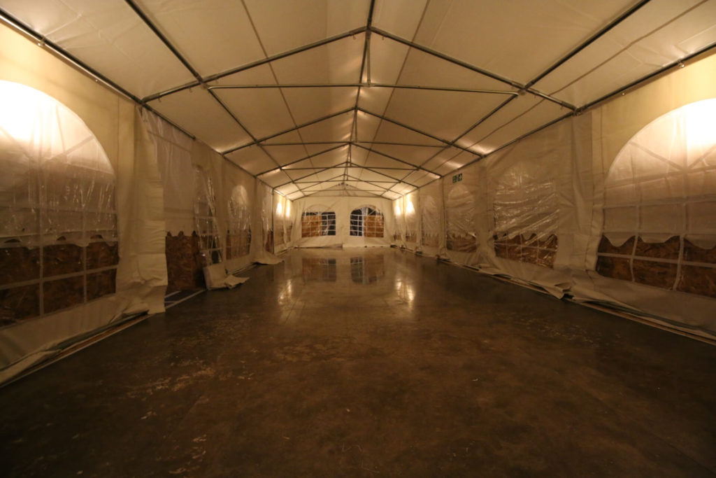 A marquee inside to protect a construction project